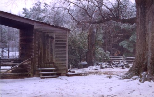 Open barn in the snow